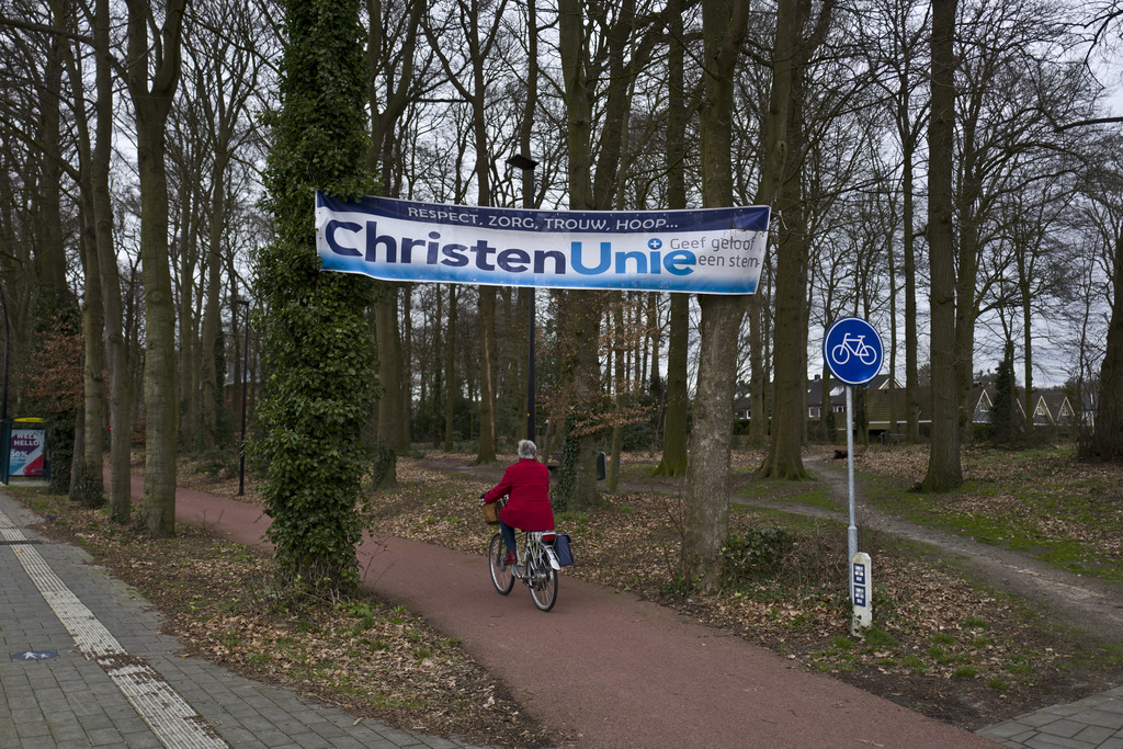 In this Saturday, March 4, 2017 photo, an election banner supporting the Christian Union, CU, is hung on trees in a cycling lane in Put...