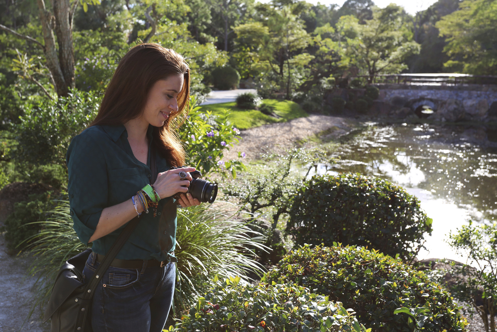 In this Feb. 11, 2017 photo, Casey Anthony takes photos at the Morikami Gardens in Delray Beach, Fla. Anthony knows that much of the wo...