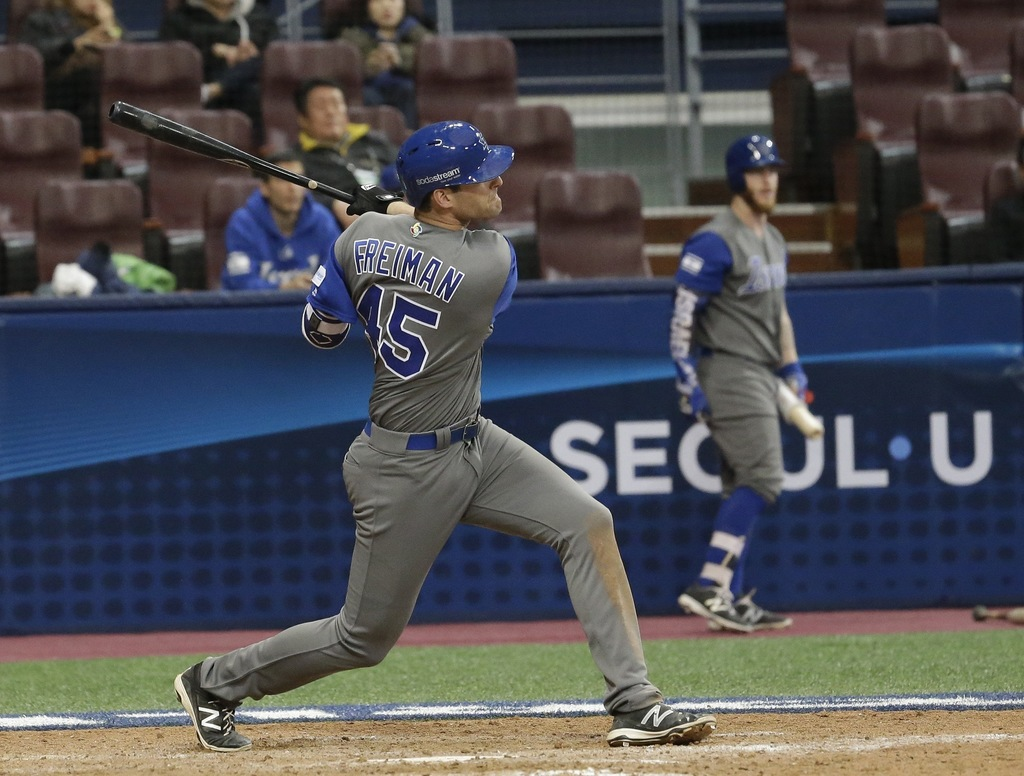 Israel's Nate Freiman hits a three-run home against Taiwan's pitcher Lo Kuo Hua during the 9th inning of their first round game of the ...