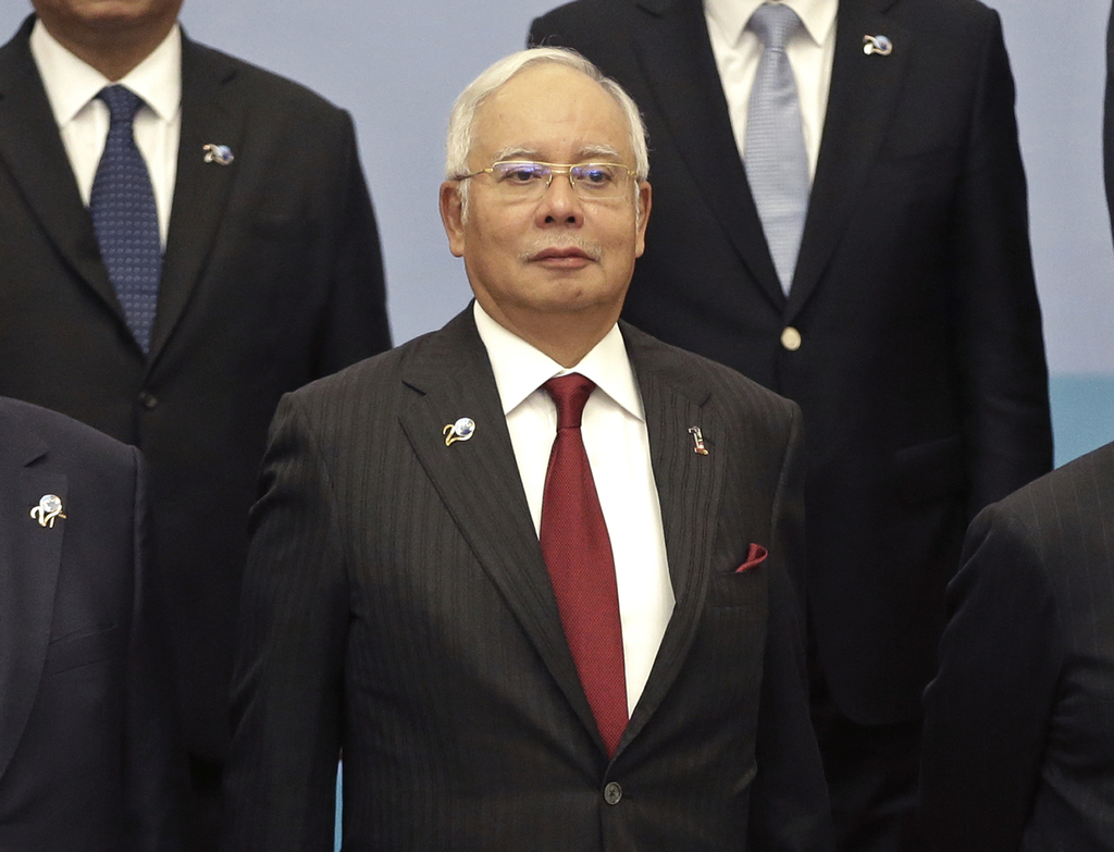 Malaysia's Prime Minister Najib Razak poses for a group photo at the Indian Ocean Rim Association (IORA) summit in Jakarta, Indonesia, ...