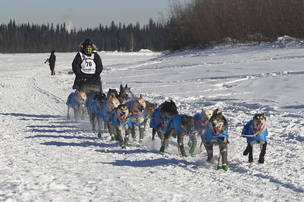 Robert Redington, the youngest of three Redington brothers competing in the 2017 Iditarod, drives his dogs down the Chena River in Fair...