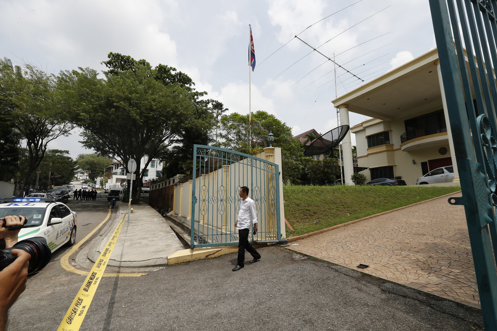 A North Korean embassy staff walks out from embassy as police puts a cordon at North Korean embassy in Kuala Lumpur, Malaysia, Tuesday,...