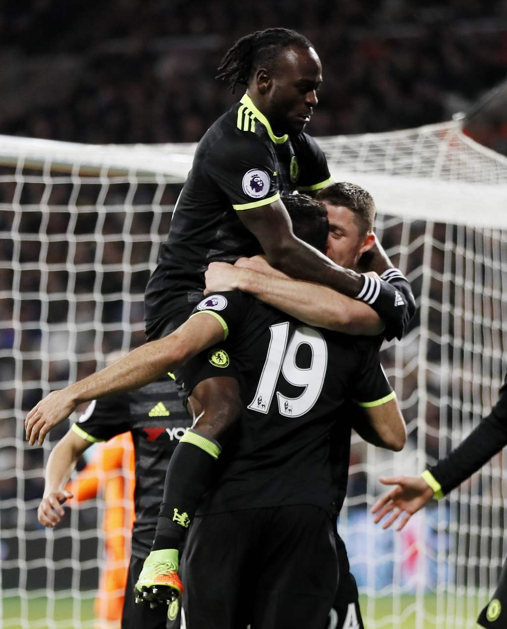 Chelsea's Diego Costa , 19, is congratulated by teammates after scoring a goal during the English Premier League soccer match between W...