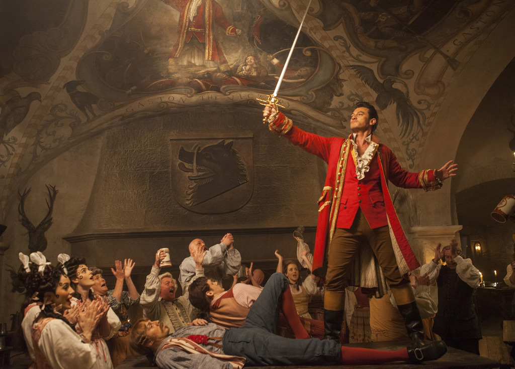 """This image released by Disney shows Luke Evans in a scene from """"Beauty and the Beast."""" (Laurie Sparham/Disney via AP)"""