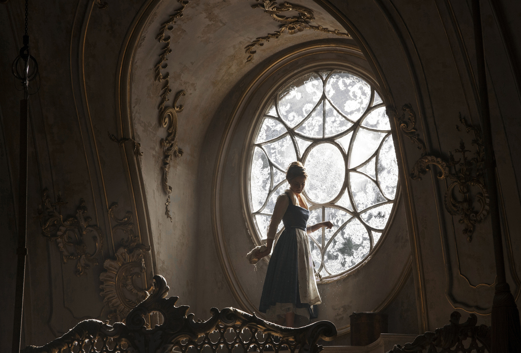 """This image released by Disney shows Emma Watson as Belle in a live-action adaptation of the animated classic """"Beauty and the Beast."""" (L..."""
