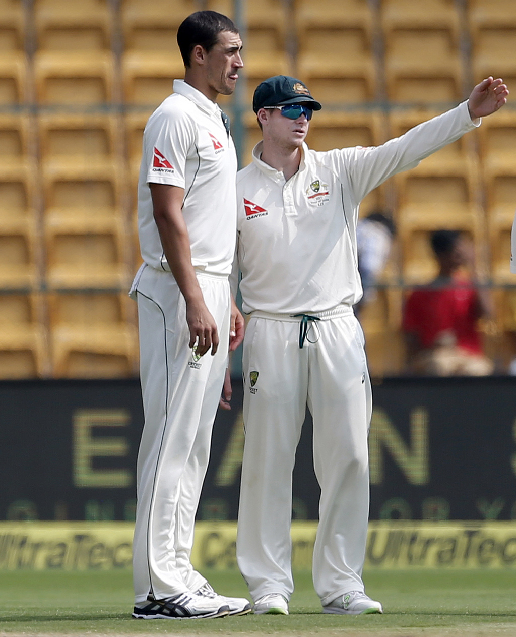Australia's captain Steven Smith, right, speaks with teammate Mitchell Starc during the fourth day of their second test cricket match a...