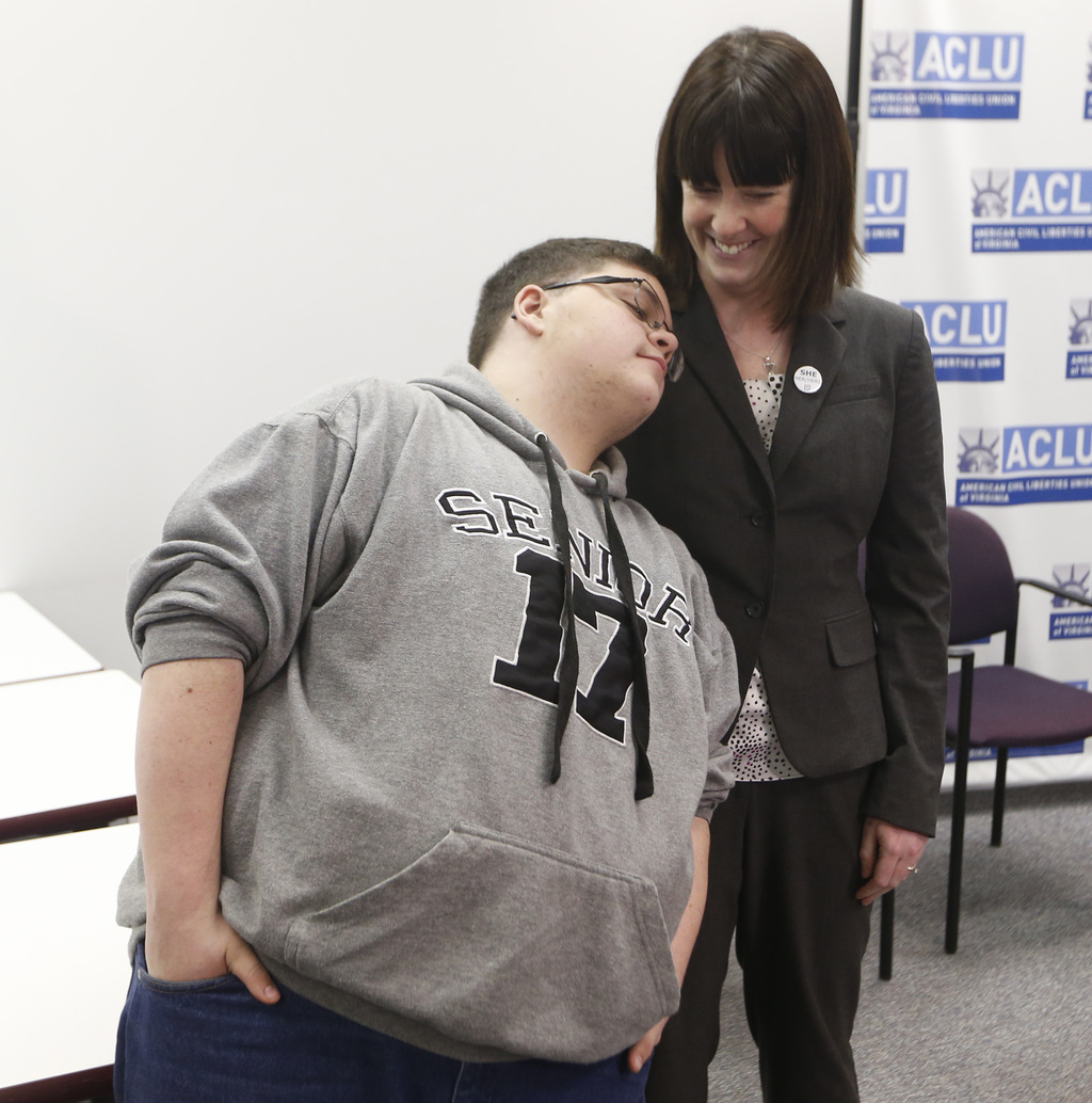 Gloucester County High School senior Gavin Grimm, a transgender student, rests his head on American Civil Liberties Union attorney Gail...