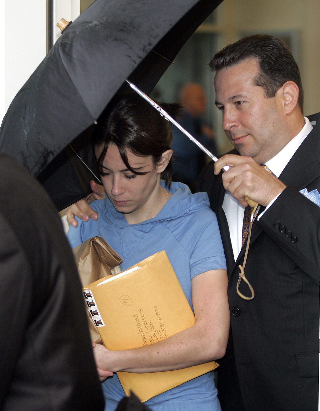 FILE- In this Aug. 21, 2008, file photo, Casey Anthony, mother of missing toddler Caylee, is escorted from the Orange County Florida ja...