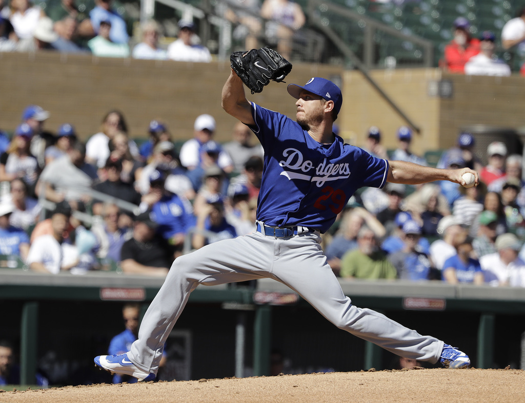 Los Angeles Dodgers' Scott Kazmir throws during the first inning of a spring training baseball game against the Colorado Rockies, Monda...