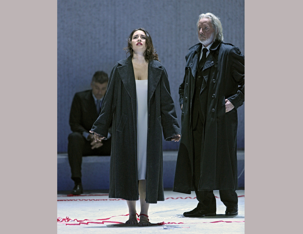 """This image released by the Metropolitan Opera shows Sonya Yoncheva, center, and James Courtney during a performance of Verdi's """"La Trav..."""