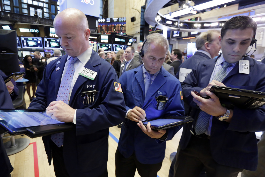 Traders work on the floor of the New York Stock Exchange, Tuesday, March 7, 2017. Stocks are opening broadly lower on Wall Street, led ...