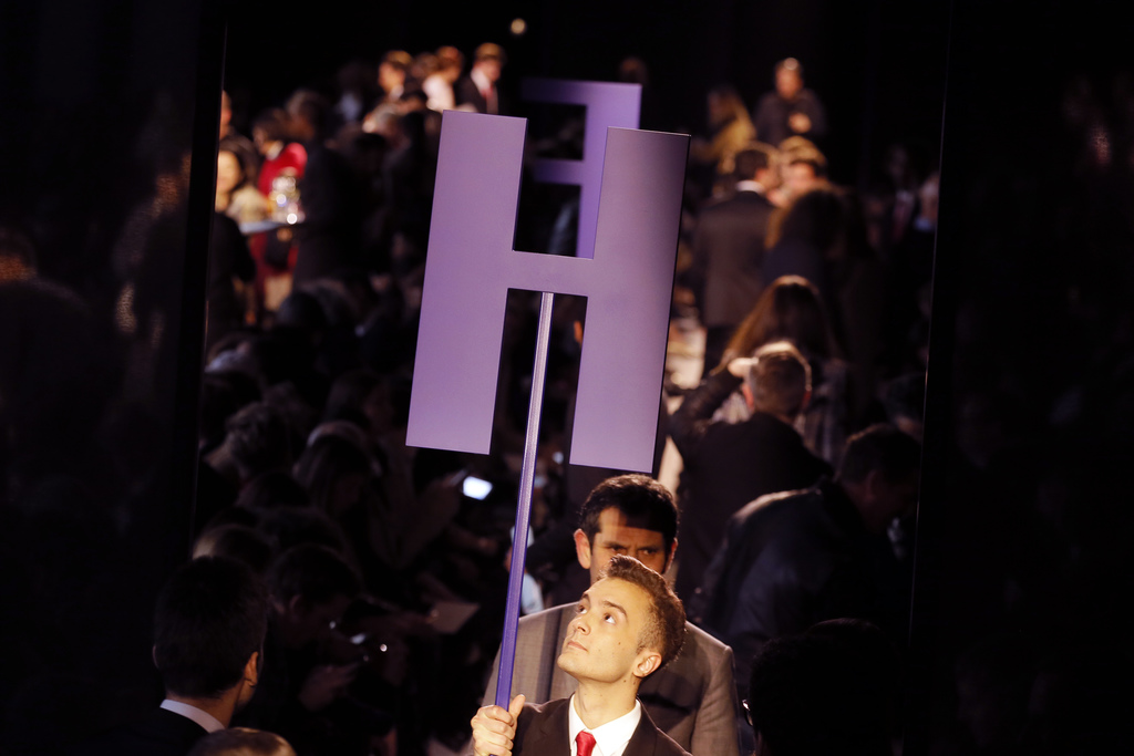A usher removes the placement letter prior to the presentation of Hermes' Fall-Winter 2017/2018 ready-to-wear fashion collection presen...