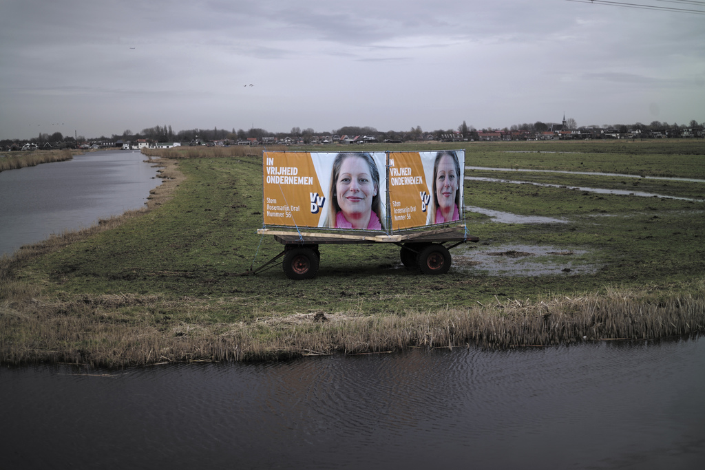 In this Friday, March 3, 2017 photo, an election banner showing Rosemarijn Dral, from the People's Party for Freedom and Democracy, VVD...