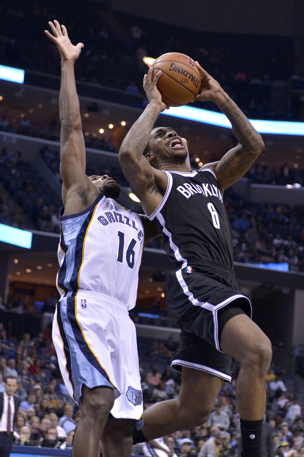 Brooklyn Nets guard Sean Kilpatrick (6) shoots against Memphis Grizzlies guard Toney Douglas (16) in the second half of an NBA basketba...