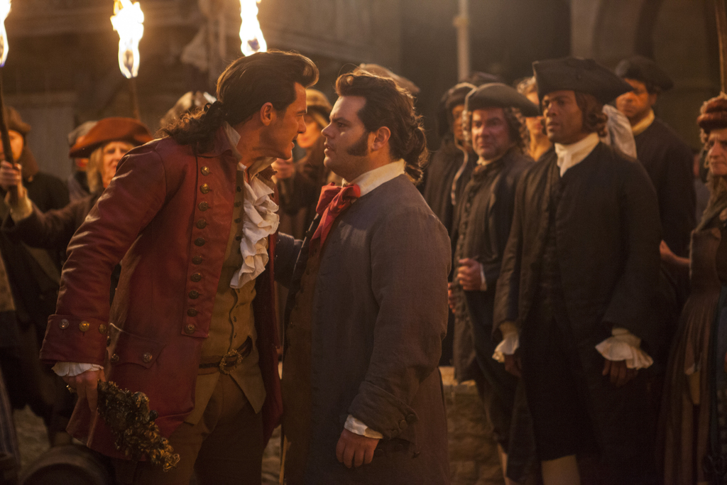 """This image released by Disney shows Luke Evans as Gaston, left, with Josh Gad as LeFou, in """"Beauty and the Beast."""" (Laurie Sparham/Disn..."""