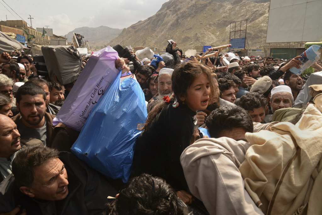 Afghanistan nationals wait to cross the Torkham border post in Pakistan en route to Afghanistan, Tuesday, March 7, 2017. Thousands of A...