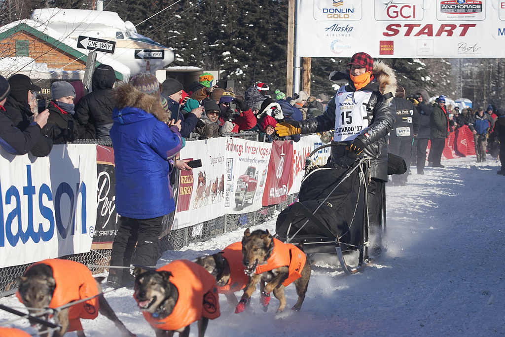 Martin Buser (15) drives his team down the start chute of the 45th Iditarod Trail Sled Dog Race in Fairbanks, Alaska, Monday, March 6, ...
