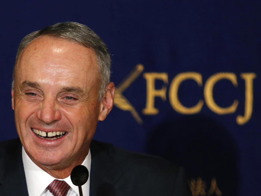 Major League Baseball Commissioner Rob Manfred laughs during a press conference in Tokyo, Tuesday, March 7, 2017. Manfred denied report...