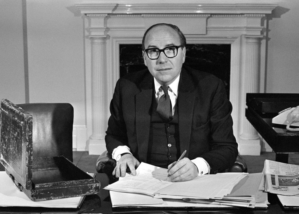 FILE - In this March 13, 1968 fie photo  Britain's Chancellor of the Exchequer, Roy Jenkins, at his desk in the Treasury Building, in L...