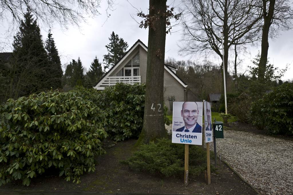 In this Saturday, March 4, 2017 photo, an election poster showing Gert-Jan Segers, from the Christian Union party, CU, is displayed by ...