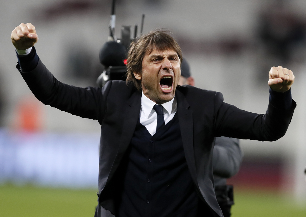 Chelsea manager Antonio Conte celebrates after his team defeated West Ham 2-1 in their English Premier League soccer match at London St...