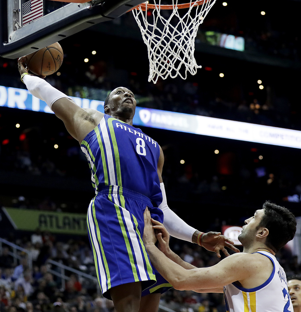 Atlanta Hawks' Dwight Howard, left, looks to dunk against Golden State Warriors' Zaza Pachulia, of the Republic of Georgia, but misses ...