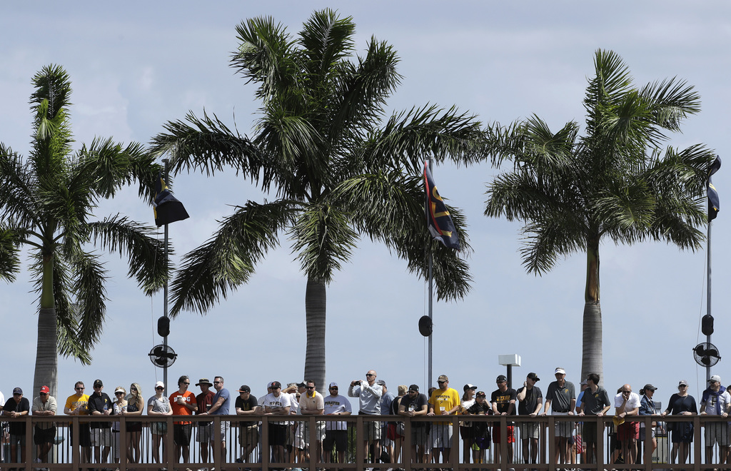 Fans watch from a boardwalk during the first inning of a spring training baseball game between the Pittsburgh Pirates and the New York ...
