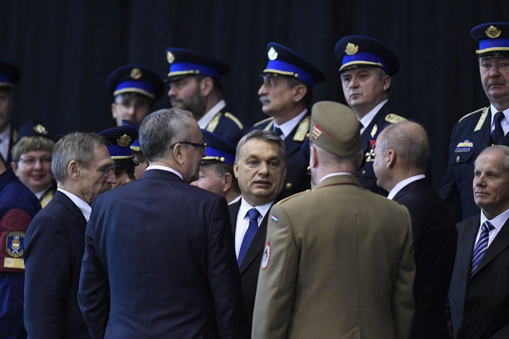 "Hungarian Prime Minister Viktor Orban, center, attends a swearing-in-ceremony for a new group of border guards known locally as ""border..."