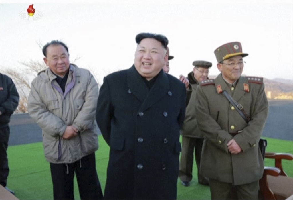 In this images made from video released by KRT on Tuesday, March 7, 2017, North Korean leader Kim Jong Un, center, reacts during the la...