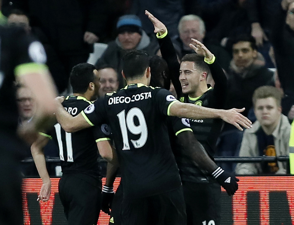 Chelsea's Eden Hazard, right, is congratulated by teammates after scoring a goal during the English Premier League soccer match between...
