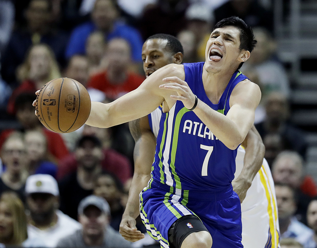 Atlanta Hawks' Ersan Ilyasova, right, of Turkey, reacts as he's fouled by Golden State Warriors' Andre Iguodala, rear, in the first qua...