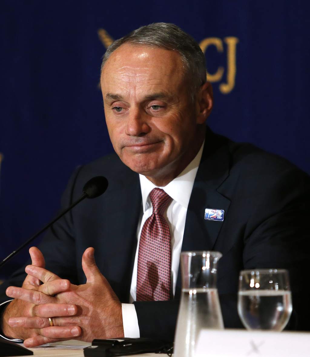 Major League Baseball Commissioner Rob Manfred speaks to journalists during a press conference in Tokyo, Tuesday, March 7, 2017. Manfre...