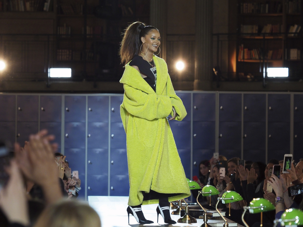 Singer and fashion designer Rihanna acknowledges applause at the end of her Fall-Winter 2017/2018 ready-to-wear collection for Fenty as...