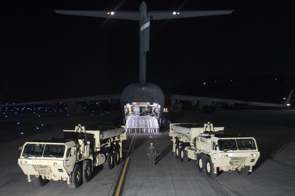 In this photo provided by U.S. Forces Korea, trucks carrying parts of U.S. missile launchers and other equipment needed to set up Termi...