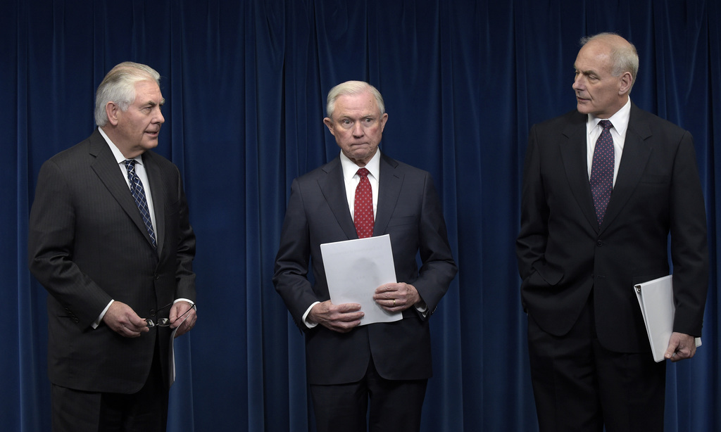 From left, Secretary of State Rex Tillerson, Attorney General Jeff Sessions and Homeland Security Secretary John Kelly, arrive for a ne...