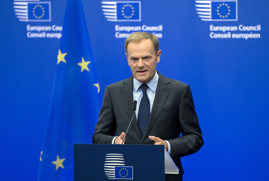 FILE - In this file photo dated Wednesday, Nov. 9, 2016, European Council President Donald Tusk reads a statement during a media confer...