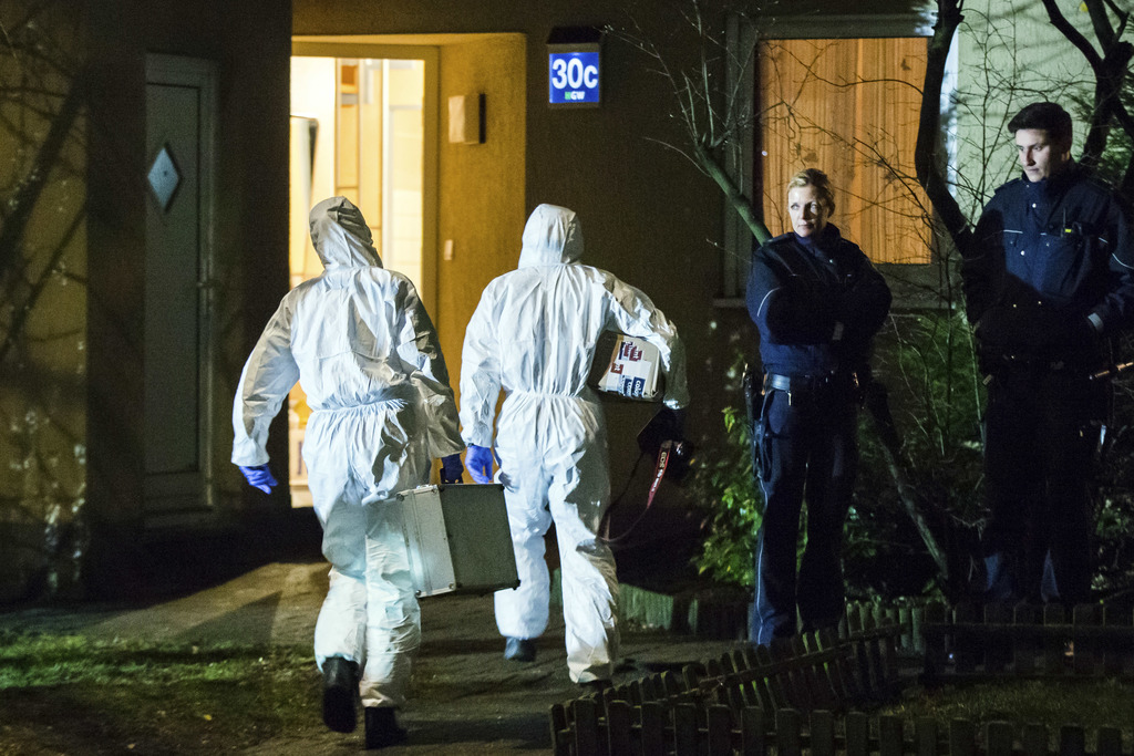Forensic scientists enter a house in Herne, Germany, Tuesday, March 7, 2017. German police said Tuesday they have launched a manhunt fo...
