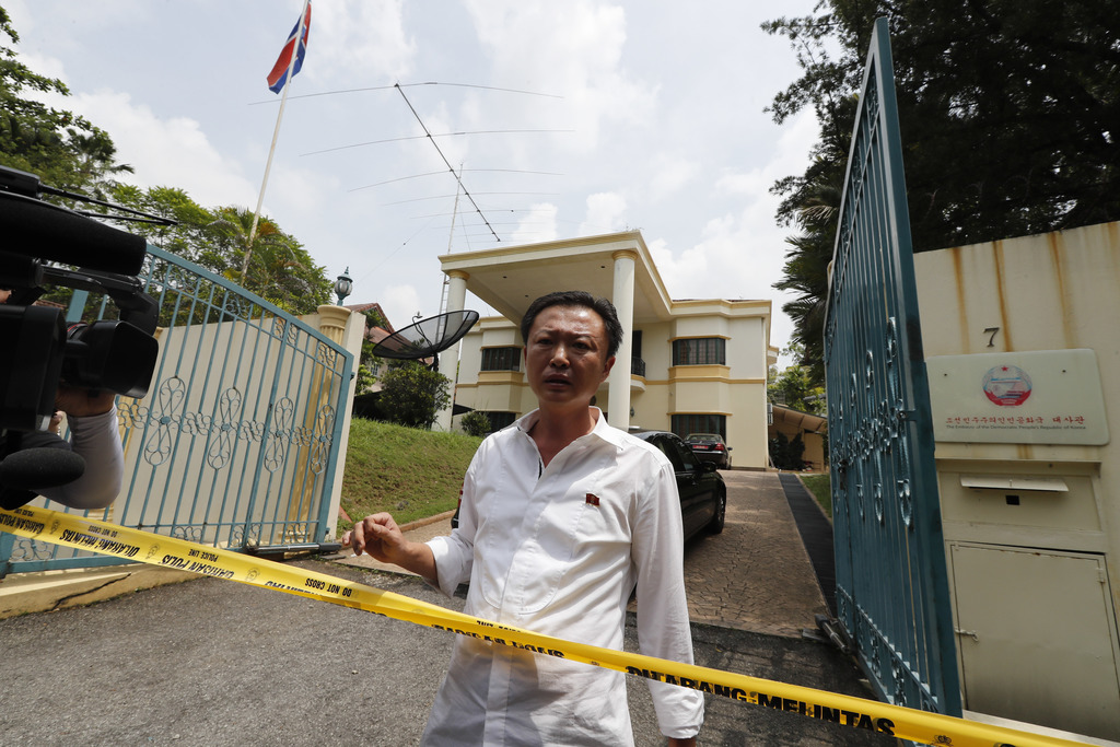 A North Korean embassy staff asks police if they are allowed to leave as police puts a cordon at North Korean embassy in Kuala Lumpur, ...