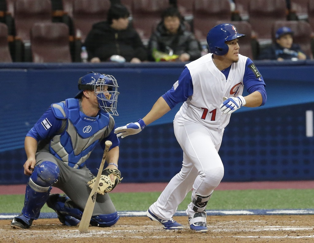 Taiwan's Chang Chih Hsien hits a single against Israel's pitcher Corey Baker during the 4th inning of their first round game of the Wor...