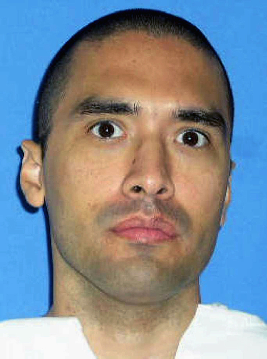 FILE - This undated file photo released by the Texas Department of Criminal Justice shows death row inmate Rolando Ruiz. Ruiz is schedu...