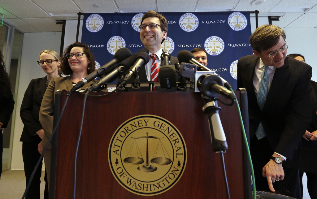 Washington State Attorney General Bob Ferguson smiles during a news conference about President Trump's new executive order Monday, Marc...