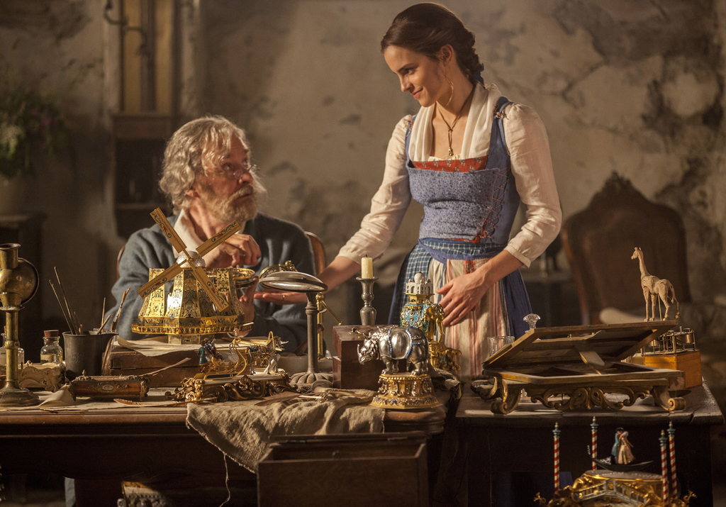 """This image released by Disney shows Emma Watson as Belle, right, and Kevin Kline as Maurice in a scene from """"Beauty and the Beast."""" (La..."""