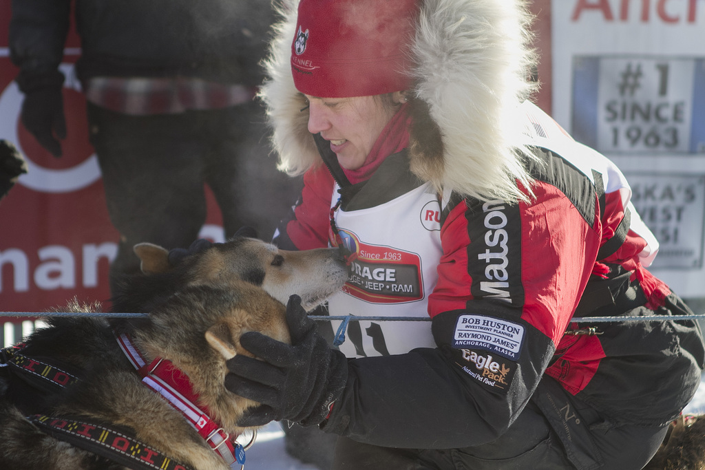 Aliy Zirkle takes a moment with her dogs at the start of the 45th Iditarod Trail Sled Dog Race in Fairbanks, Alaska, Monday, March 6,20...