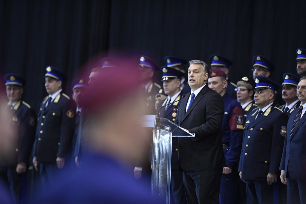 Hungarian Prime Minister Viktor Orban,delivers a speech during a swearing-in-ceremony for a new group of border guards known locally as...