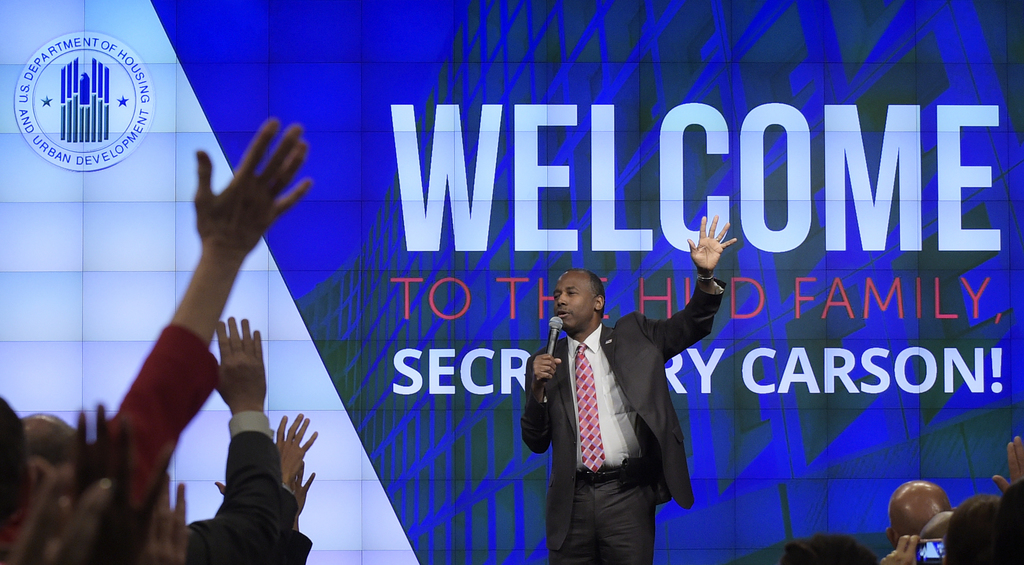 Housing a Urban Development Secretary Ben Carson asks people to raise their hands and take the nice challenge as he speaks to HUD emplo...