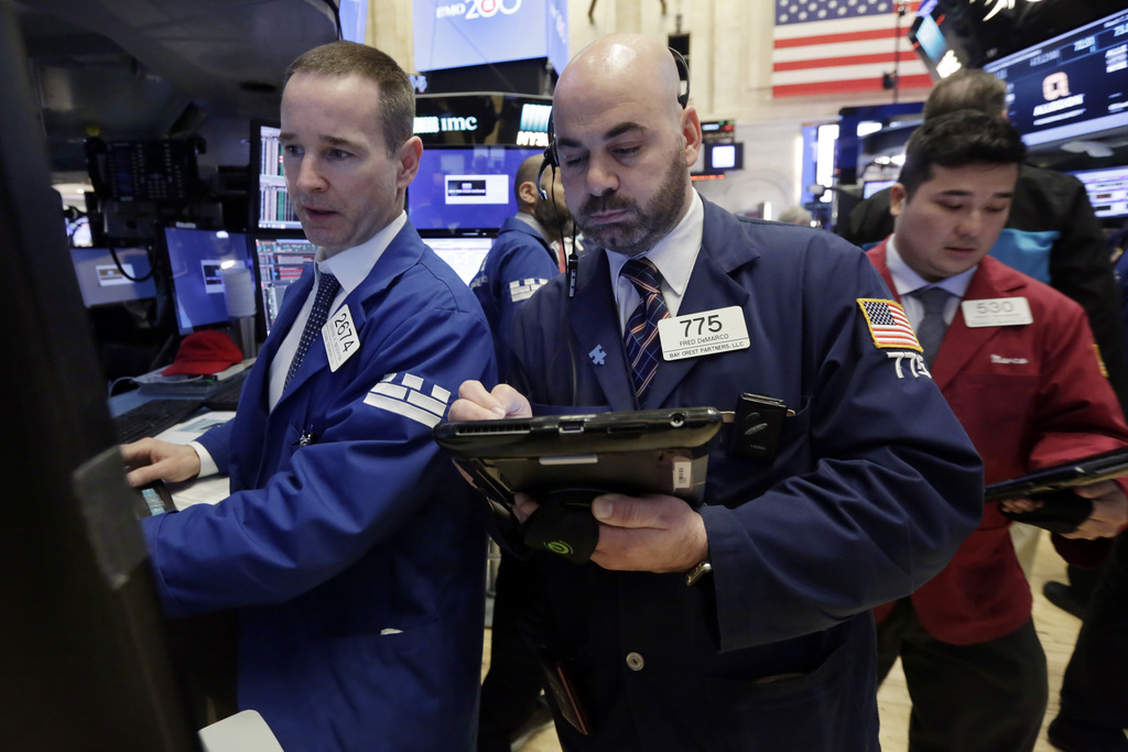 Specialist Stephen Naughton, left, and trader Fred Demarco, center, work on the floor of the New York Stock Exchange, Tuesday, March 7,...