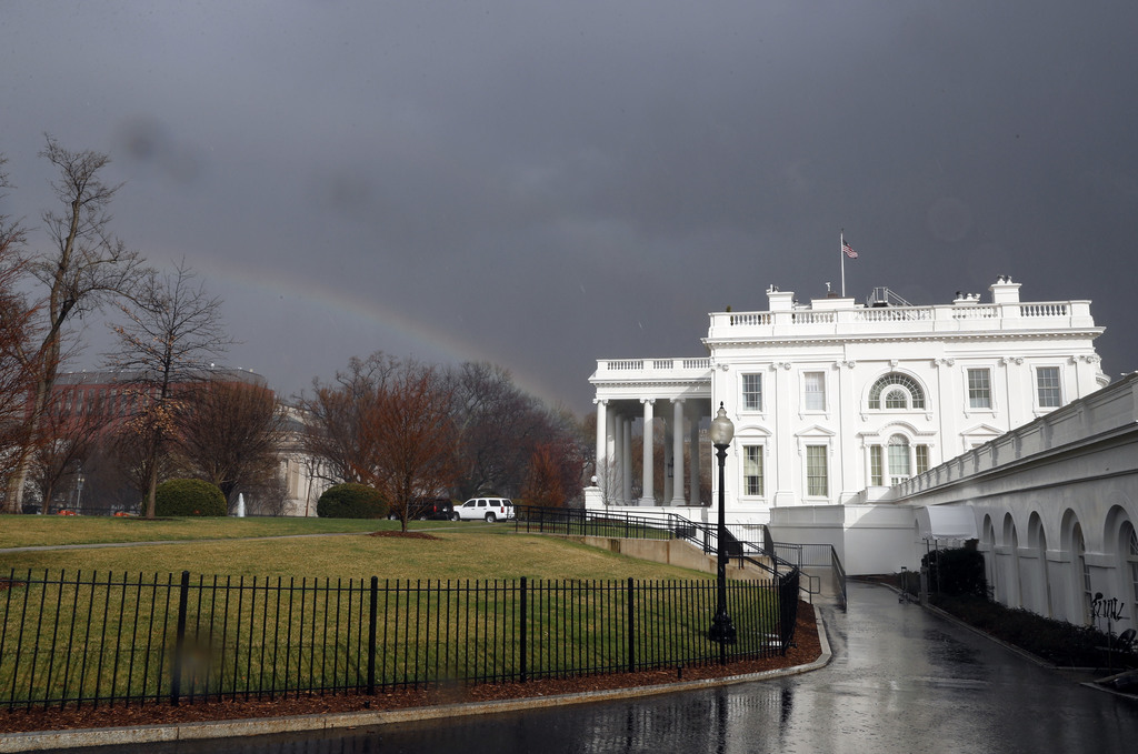 FILE - In this Saturday, Feb. 25, 2017, file photo, a rainbow is seen next to the White House as a cold front passes through the area i...