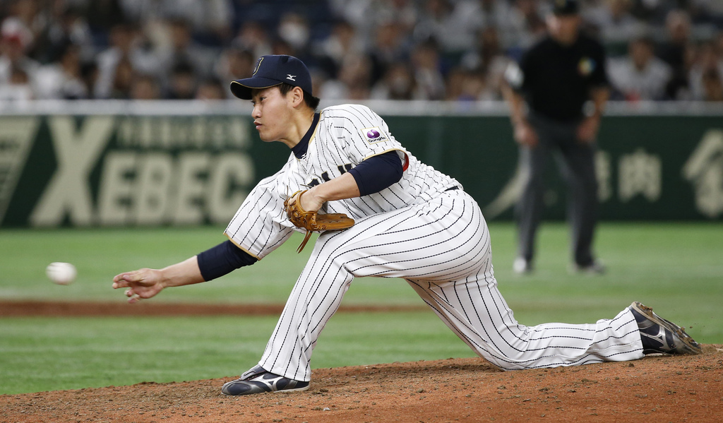 Japan's closer Kazuhisa Makita pitches against Cuba in the ninth inning to beat Cuba 11-6 in their first round game of the World Baseba...