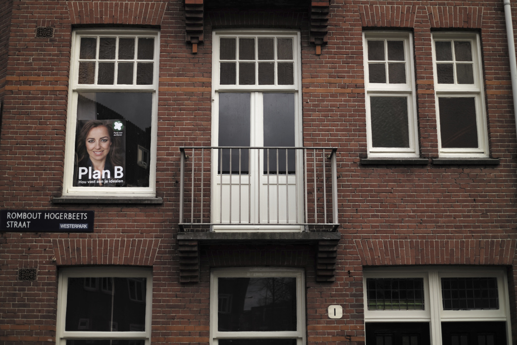 In this Wednesday, March 1, 2017 photo, an election poster showing Marianne Thieme, from the Party for the Animals, PvdD, is displayed ...