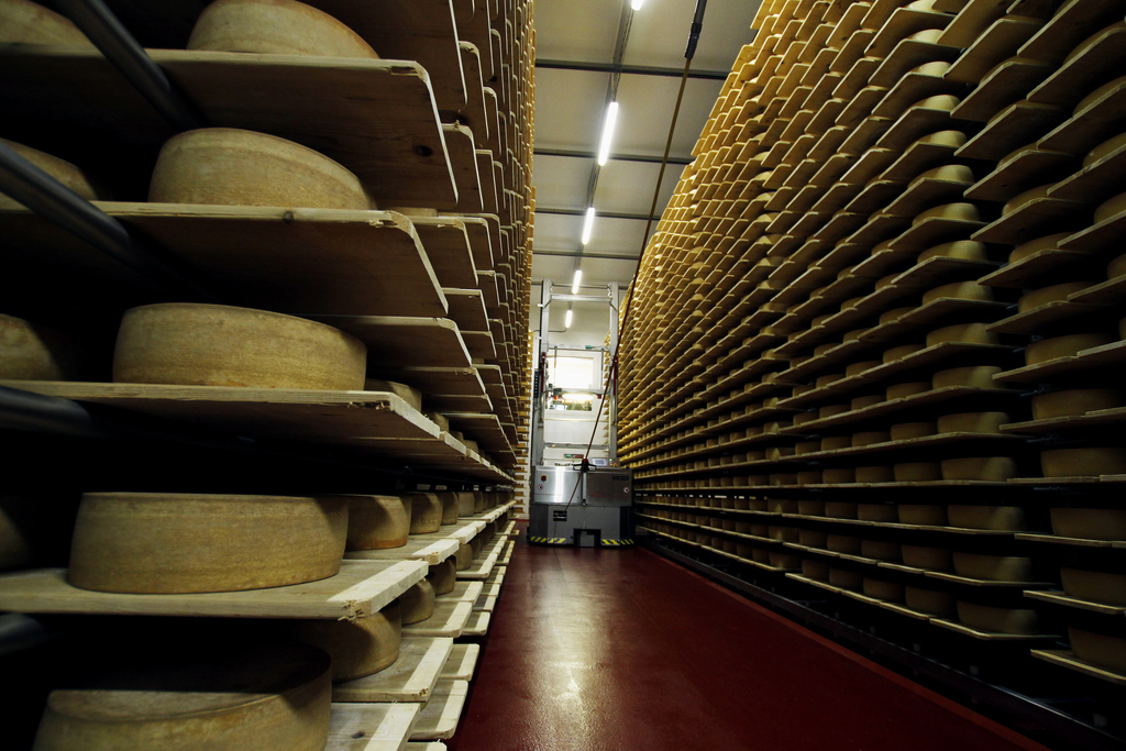 In this Feb. 27, 2017, photo, wheels of Grand Cru Surchoix cheese sit on spruce planks to age for nine months at the Emmi Roth USA prod...